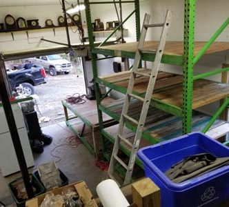 Setting up some new shelving for more clocks and  parts