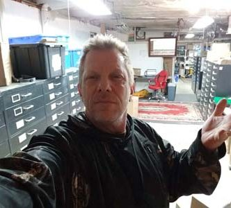 Owner and Clockmaker James Stoudenmire in the small parts dept