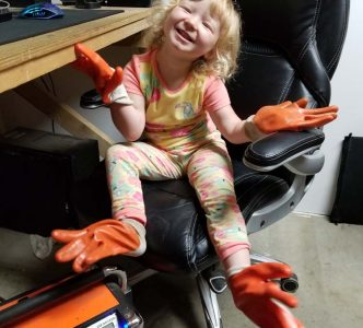 Teaching Apprentice Kathleen about safety equipment